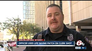 Officer uses life saving patch on Family Dollar store clerk shot during armed robbery - Video