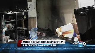 Two people lose mobile home in blaze - Video