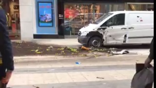Pedestrians Seek Shelter After Truck Crashes Into Stockholm Department Store - Video