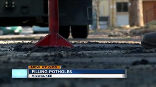 Milwaukee potholes under repair after warming weather - Video