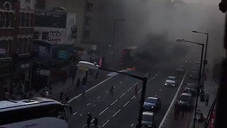 Bus Catches Fire at London's Finchley Road Stop - Video