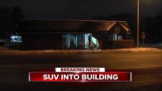 SUV slams into building on Woodward in Royal Oak - Video