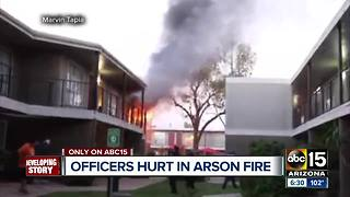 Woman arrested after home set on fire, 8 officers sent to hospital - Video