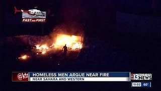 Two homeless Las Vegas men argue near fire - Video