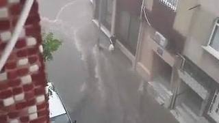 Stream of Water Flows Down Istanbul Street Amid Thunderstorm - Video