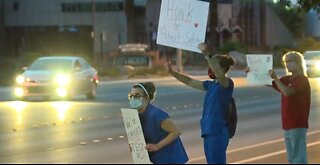 Vegas nurses hold 'Patients before profits' signs