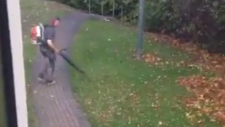 Dublin Leaf Blower Blows On Despite of Ex-Hurricane Ophelia Winds - Video