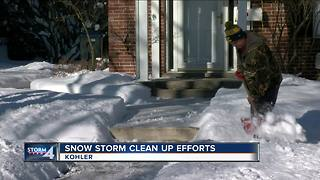 Kohler residents clean up after heavy snowfall - Video