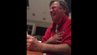 Dad's reaction to adult card game results in hysterical laughter - Video