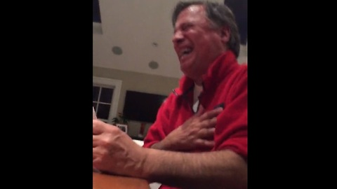 Dad's reaction to adult card game results in hysterical laughter