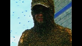 Guy Covered in 500,000 Bees - Video