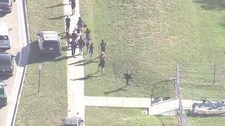 Students evacuate building after mass shooting