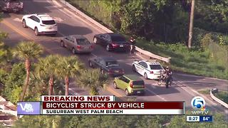 Bicyclist hit by vehicle in suburban West Palm Beach - Video
