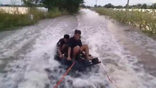 Wakeboarding a flooded road in Thailand