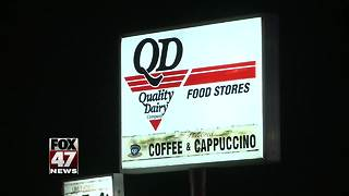Lansing police investigating early morning robbery at Quality Dairy - Video