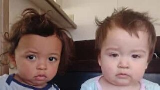 Baby twins trapped inside cupboard