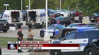 Two police officers shot at Willoughby Hills car dealership - Video