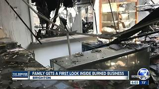 Family gets a first look inside burned businesses after Brighton fire - Video