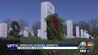 Volunteers place wreaths on tombstones at Arlington National Cemetery - Video