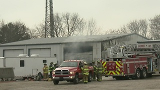 Man injured in repair shop fire - Video
