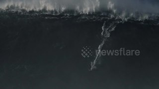 Surfer rides monster wave off Nazare - Video