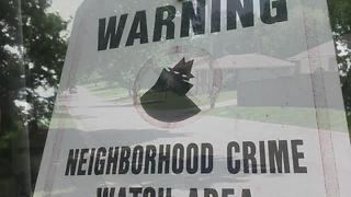 Police officers, mayor and other city leaders door-knock to give crime prevention tips - Video