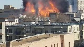 Large Construction Site Fire Burns Along Denver Skyline - Video