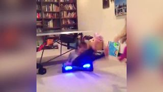 """""""A Young Boy Spins on A Hoverboard and Gets Slammed"""""""