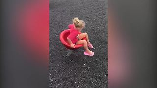 Little Girl Gets Dizzy After Spinning On A Playground