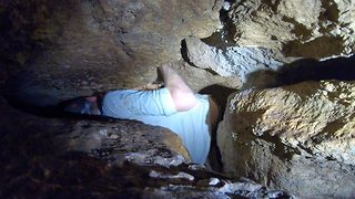 In a tight spot – Giant student squeezes into tiny cave - Video