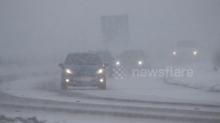 Vehicles battle through snow in Northern Ireland - Video