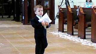 Cute Ring Bearer Takes His Precious Time And Slowly Walks Down The Aisle - Video