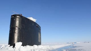 Stunning footage shows US submarine breaking through Arctic ice - Video