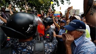 Opposition Protesters Scuffle With Authorities As Blackout Continues