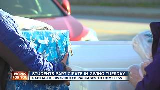 Baltimore students assemble, distribute packages to homeless for Giving Tuesday