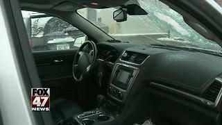 Concrete lands on car on Michigan freeway - Video