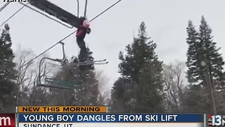 Young boy dangles from ski lift - Video