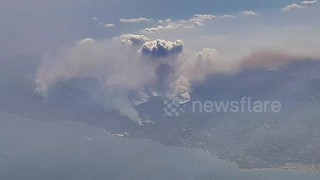 Flying over a huge wildfire near Athens, Greece - Video