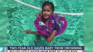 Two-year-old girl saves baby sister from drowning - Video