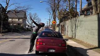 Man performs spectacular backflip over parked car - Video