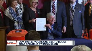 Gov. Rick Snyder signs bill for $175 million boost in road spending - Video