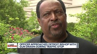 DPD officer approaches bishop with gun drawn during a traffic stop - Video