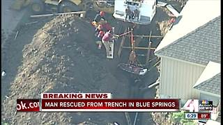 Crews rescue man from trench - Video