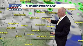 Cooler Sunday with scattered afternoon showers