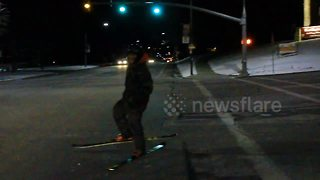 Urban skier almost gets hit by car - Video