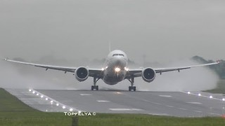 Boeing 777 Combats Wet Conditions at Birmingham Airport - Video