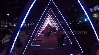People walk through light sculpture in Lumiere London festival - Video