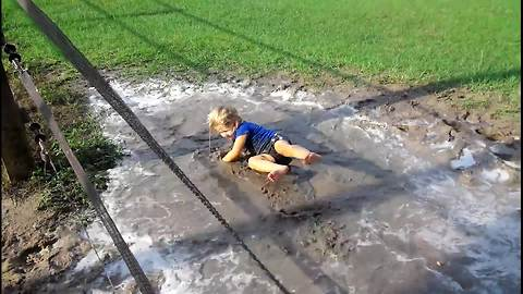 Tot Girl Falls Into A Mud Puddle