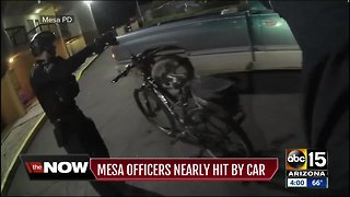 Mesa officers nearly run over