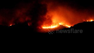 Huge wildfire rages on hillside in Corsica - Video